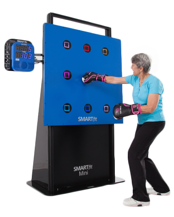 Woman wearing bloxing gloves using SMARTfit for Physical Therapy