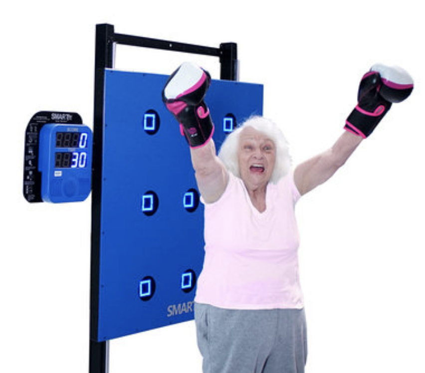 Woman wearing boxing gloves using SMARTfit