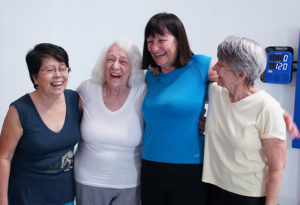 4 women smiling and laughing after using SMARTfit OS for wellness